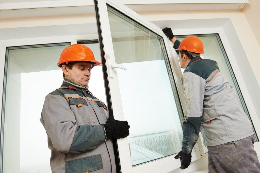2 workers replacing window