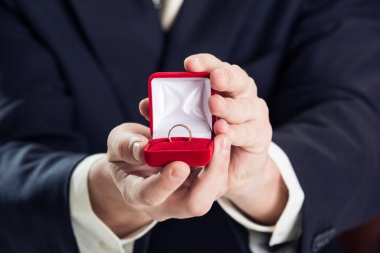 Man holding a wedding ring