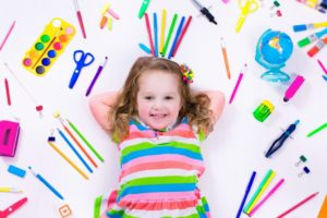 little girl with art materials