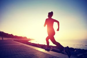 Woman jogging during sunrise