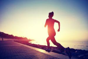 Woman jogging during sunrise