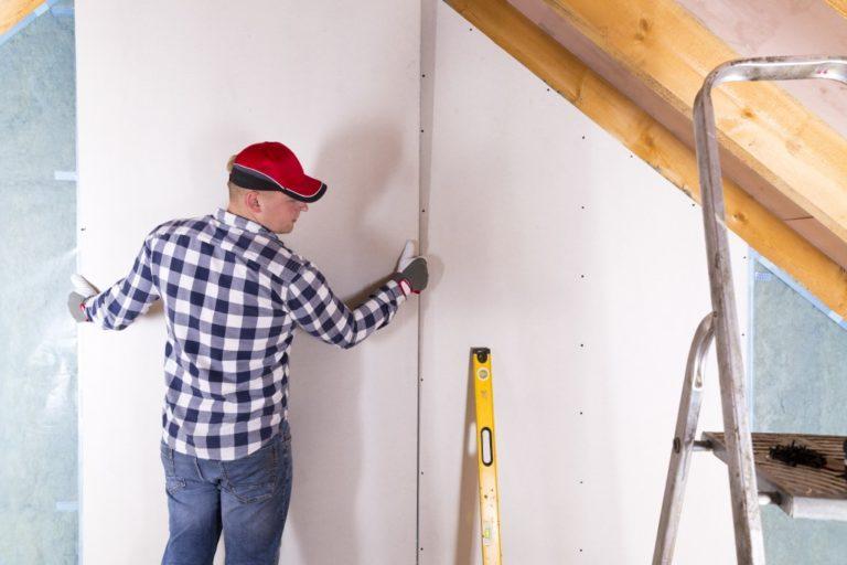 Man installing a plasterboard