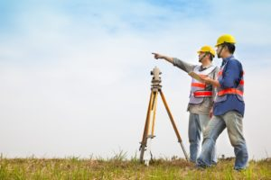 two engineers doing land survey