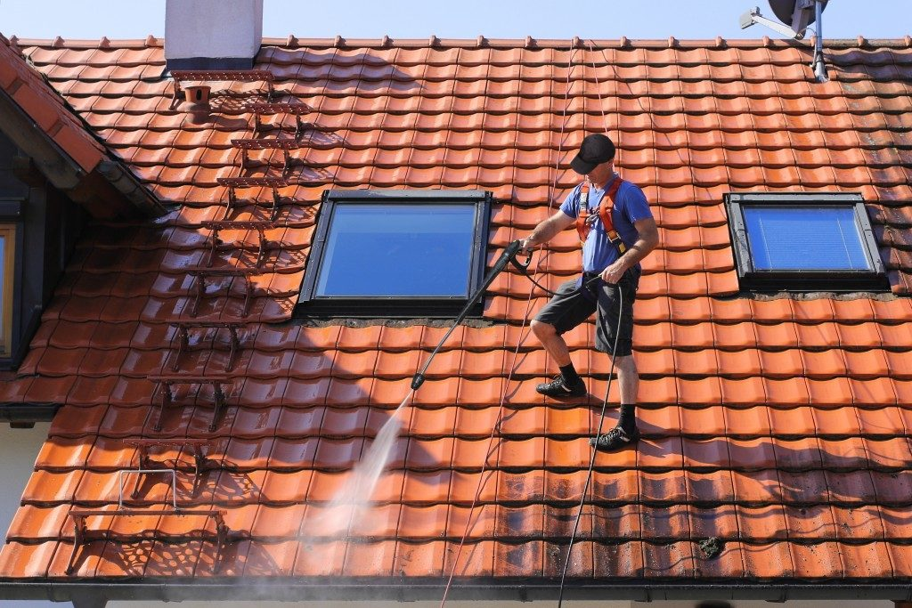 Roof cleaning with high pressure washer