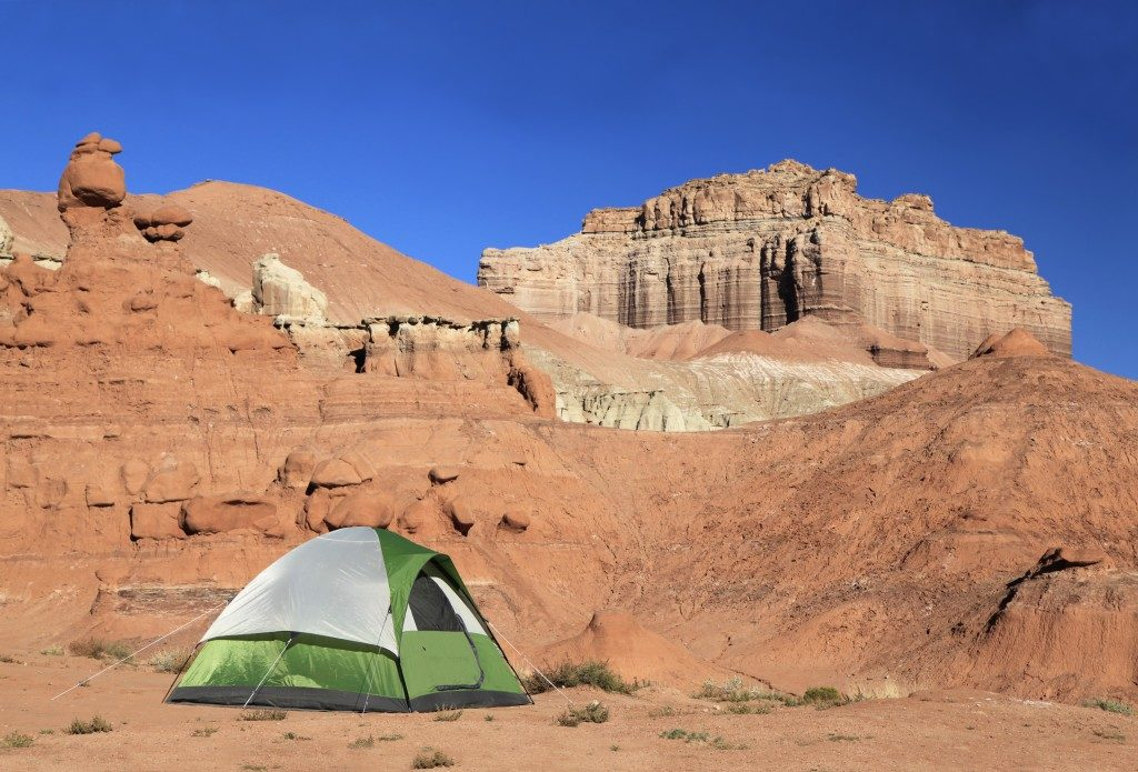 Green and white tent in the campground of Goblin Valley State Park, Utah
