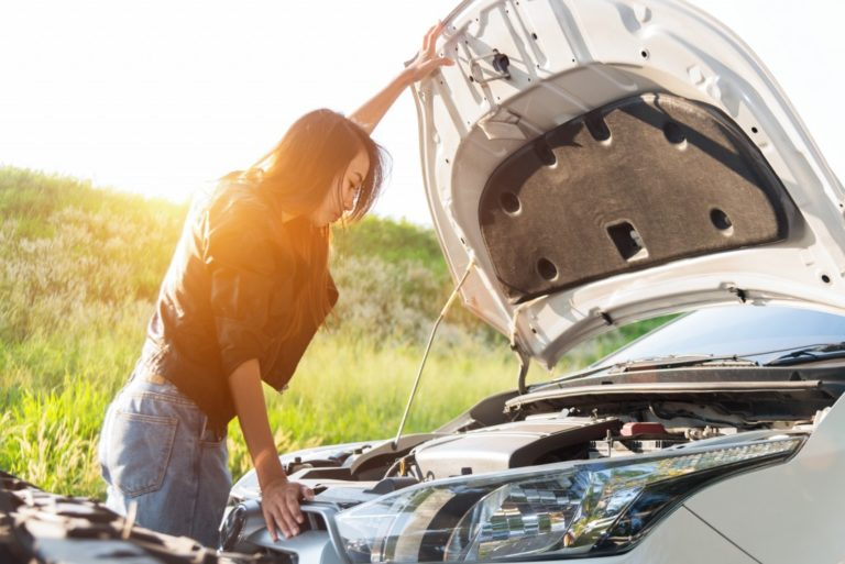 woman checking her car's engine