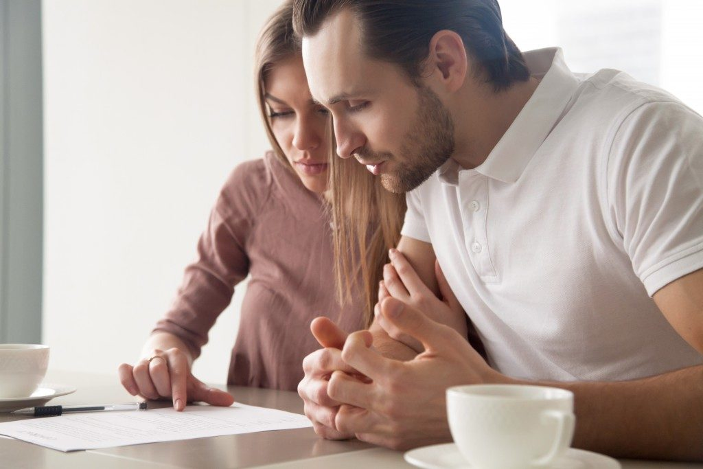 couple reviewing a document