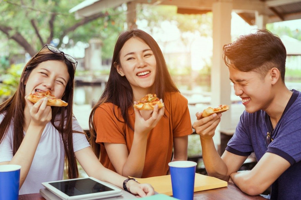 Friends enjoying pizza together