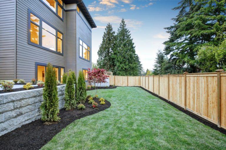 Nice backyard landscape with well kept lawn