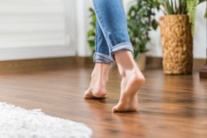Woman walking barefoot in the living room