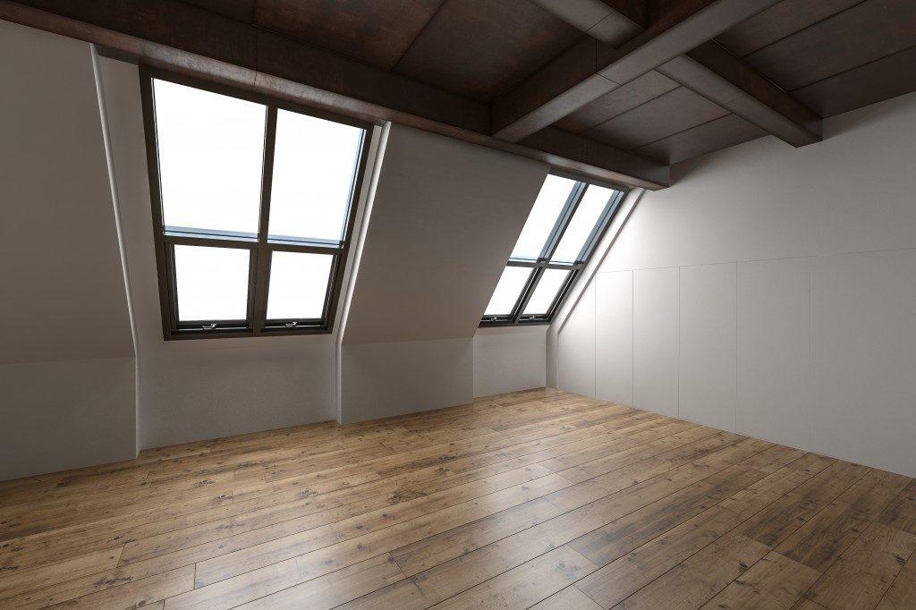 attic with hardwood flooring