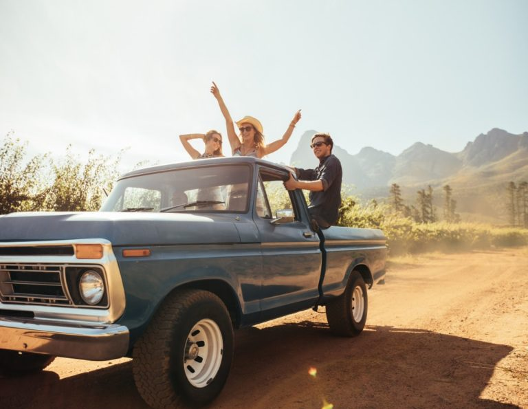 friends having fun in a pick up truck