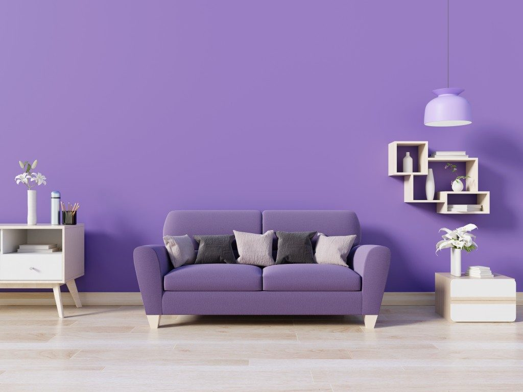purple wall with purple and white furnishing