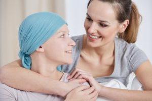 woman hugging another woman with cancer