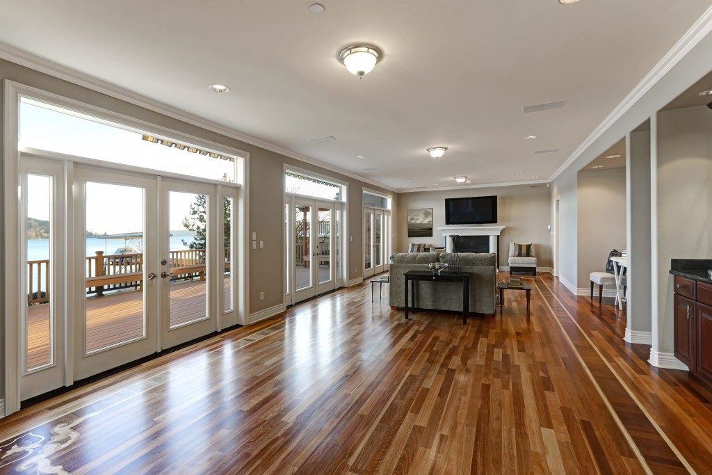 big home with hardwood flooring and ocean view outside