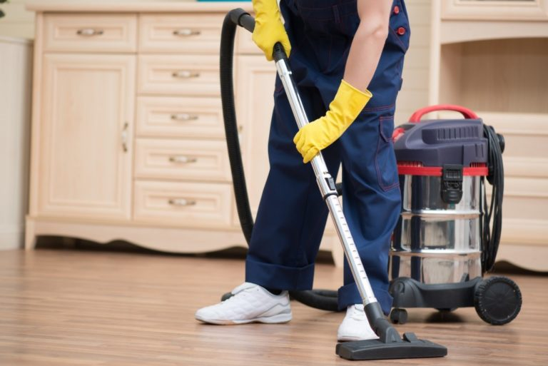cleaning floors with vacuum
