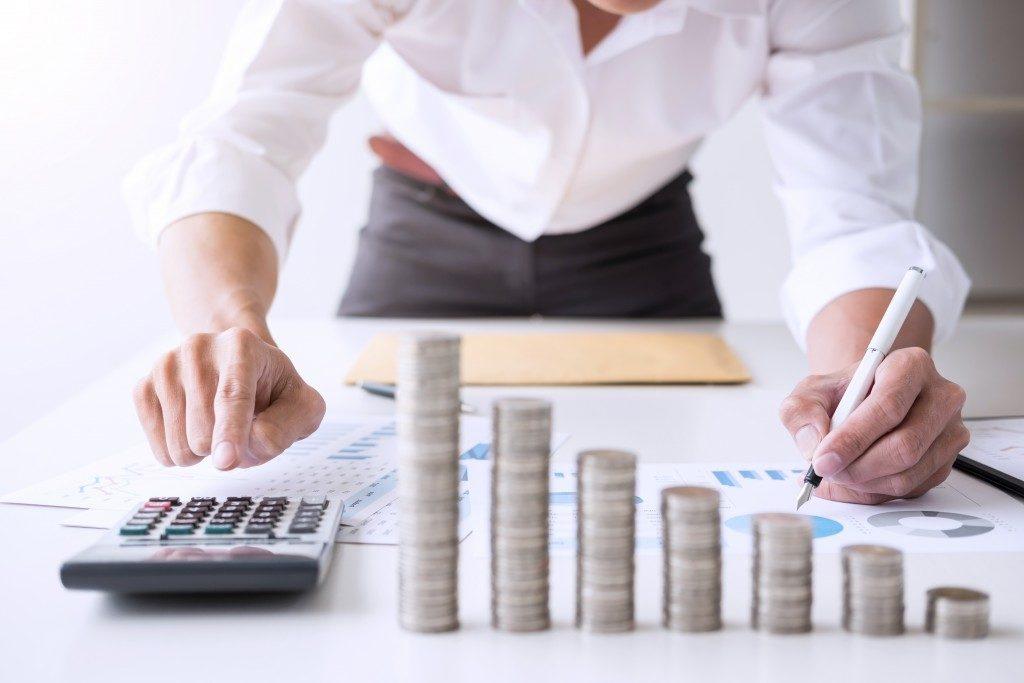 man computing his finances