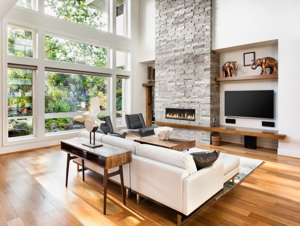 modern luxury livinig room with fireplace and big windows