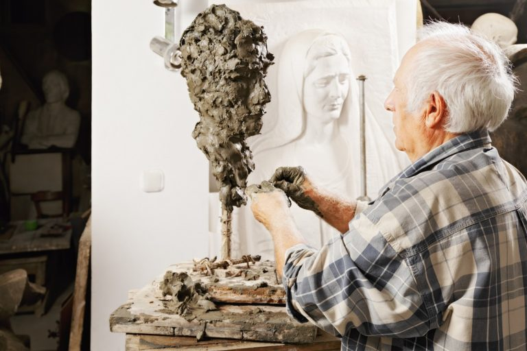 Sculptor creating a piece in the studio
