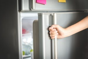 person opening the fridge