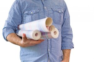 Man carrying rolls of wallpaper