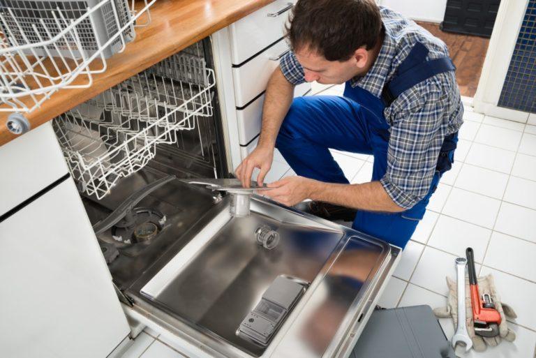 Man fixing the dishwasher