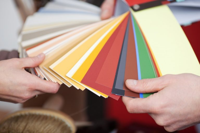 people looking through color swatches