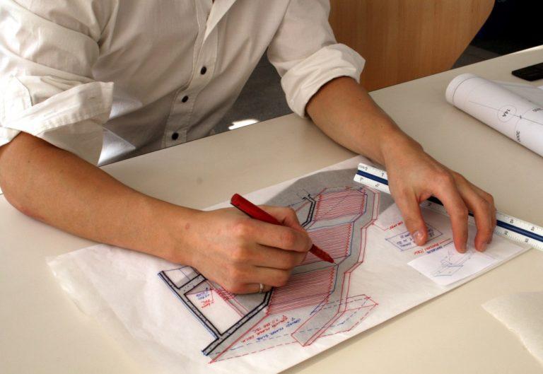 engineer drafting blueprint