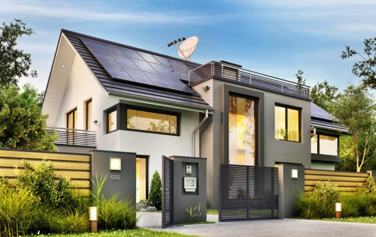 large home with solar panels and garden