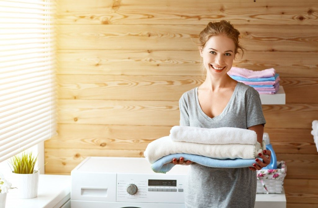woman holding towel