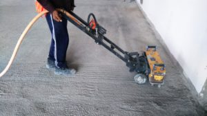 man cleaning concrete