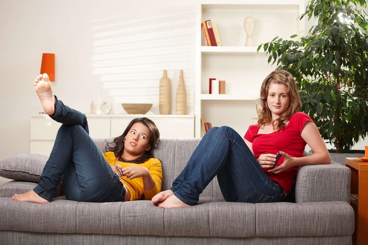 girls relaxing on the couch