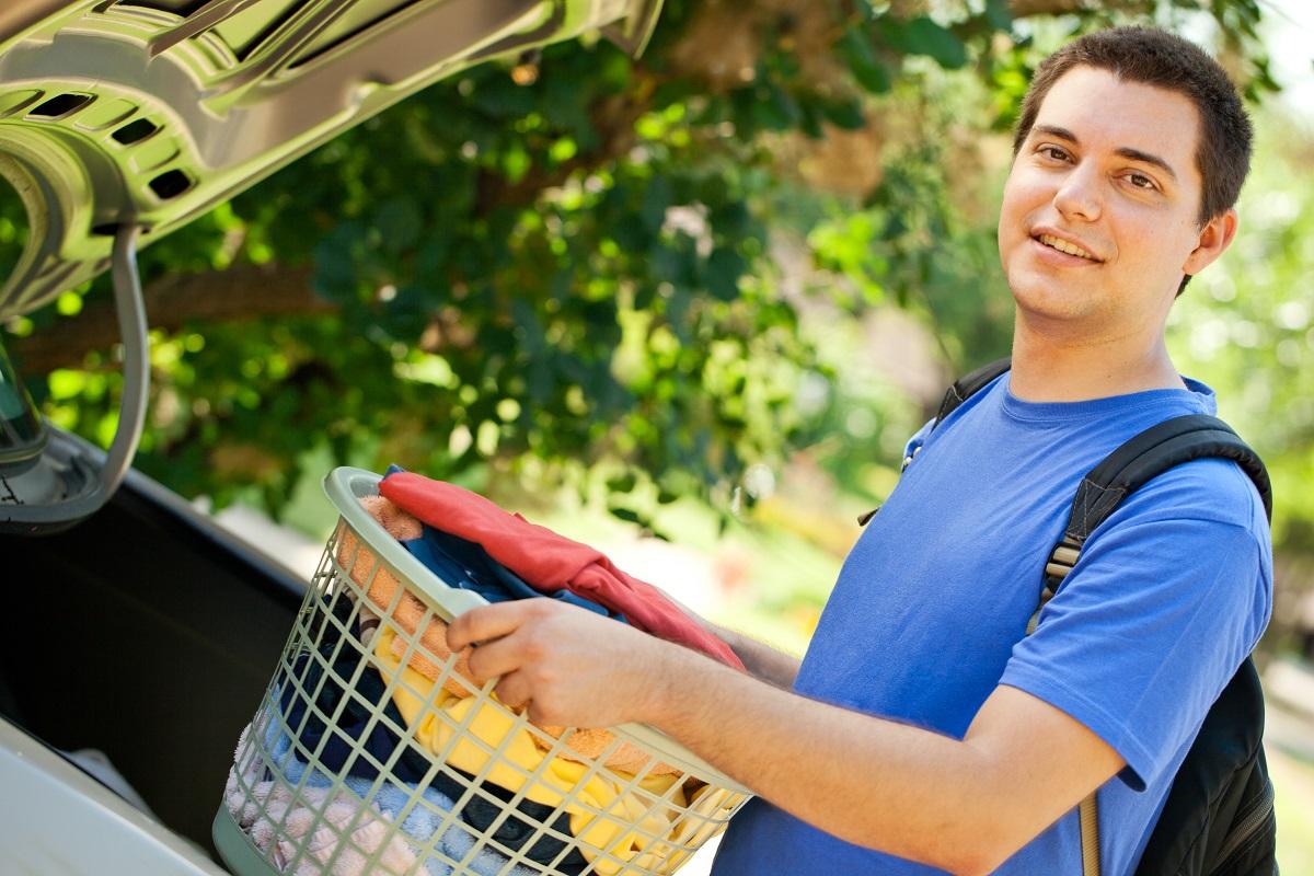 students holding laundry basket