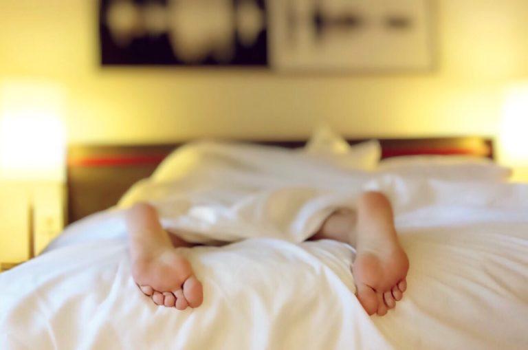 feet under a sheet