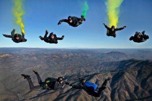 men sky diving
