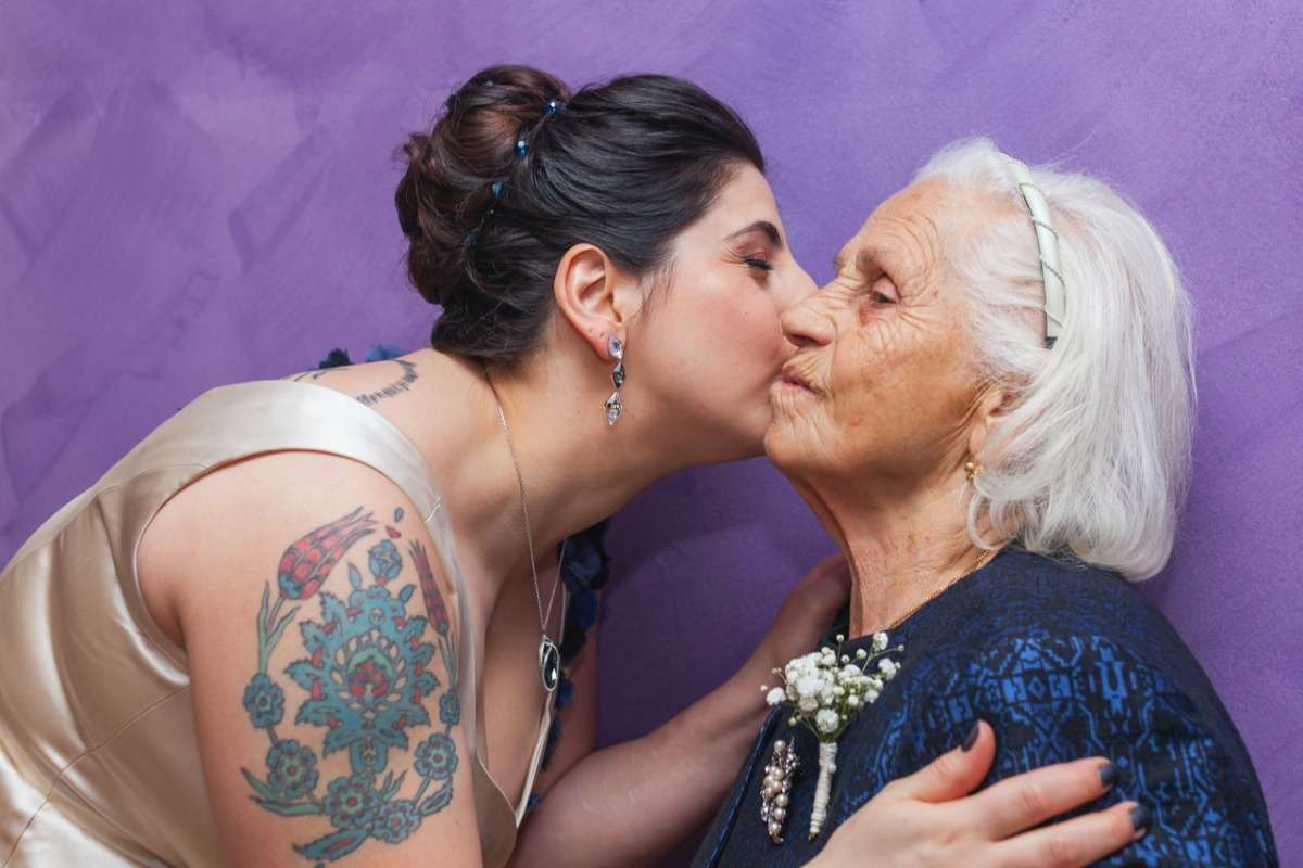 woman kissing her mother