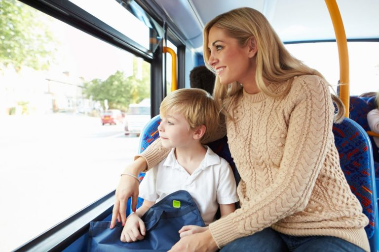 woman and child riding public transport