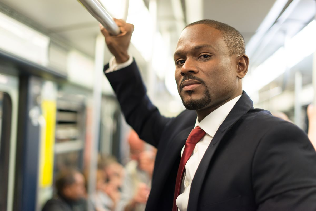 man riding light rail transit