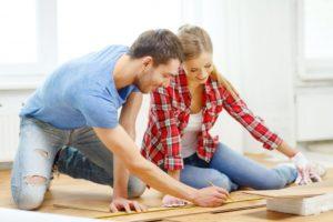 couple fixing flooring