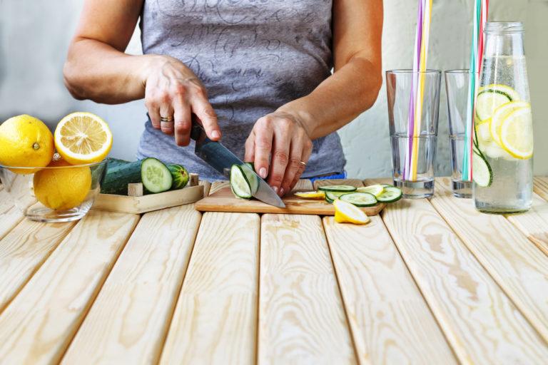 woman cutting up fruit