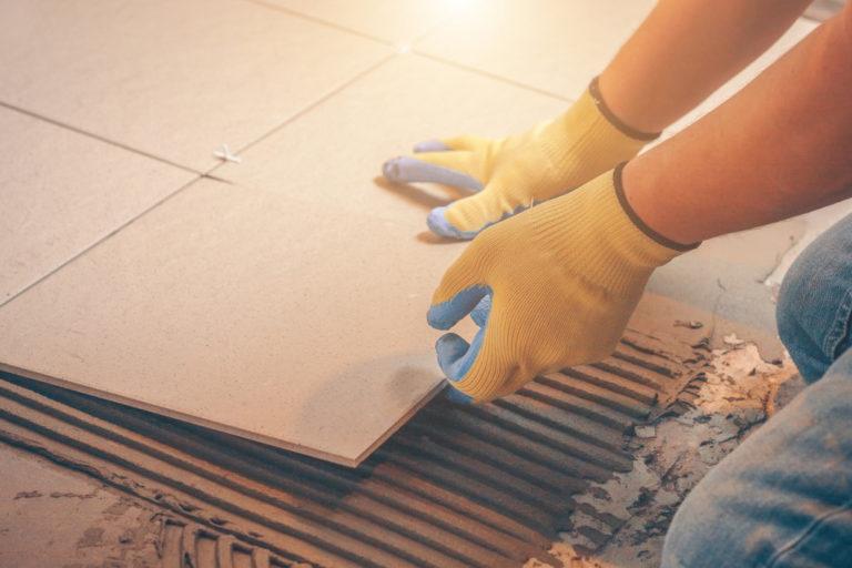 man installing tiles