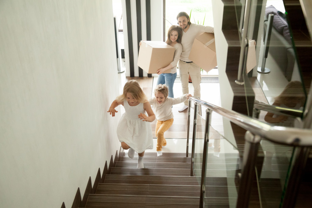 a family moving inside a new house