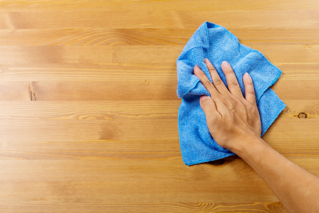 wiping wood tiles